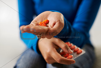 asian woman holding pills and medicine in hand