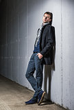 Fashion shot: portrait of handsome young man in jeans and coat