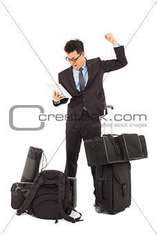Angry businessman make a fist  and holding a tablet