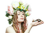 pretty girl with snail and flower crown on head