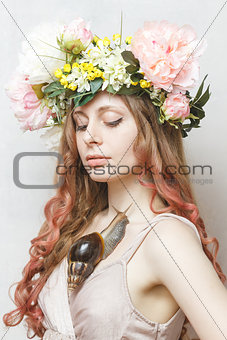 calm pretty girl with snail and flower crown on head