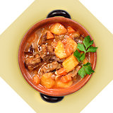 Dish of meat soup with potatoes in ceramic pot. I