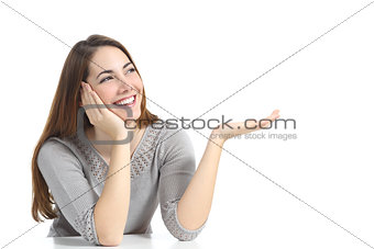Beautiful happy woman presenting a blank advertising