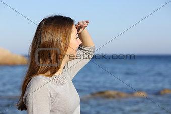 Happy woman looking forward at the horizon
