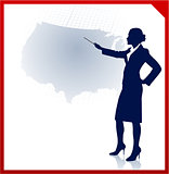 Young businesswoman pointing at usa map