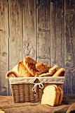 Delicious bread and rolls in a wicker basket