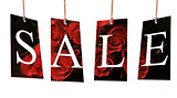 Sale labels on rose background