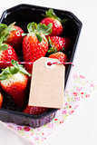 Fresh strawberries with tag