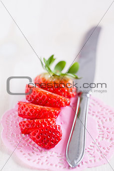 Sliced strawberry and knife