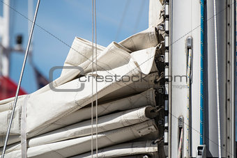 Close up image of sail and mast pulley systm on yacht sailboat