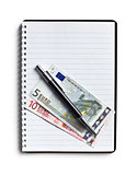 euro currency and pen on blank notebook