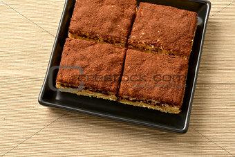 Tiramisu cake with cocoa; selective focus.