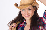 Country Girl Holds Her Gear While adjusting Cowboy Hat
