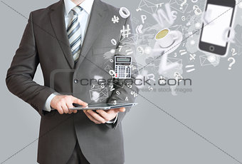 Man in suit holding tablet pc. Office work concept