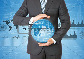 Businessman in a suit holding a globe