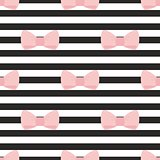 Seamless vector pattern with pastel pink bows on a black and white strip background.