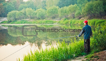 Fisherman Casting On Calm River