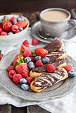 Chocolate eclairs with fresh berries