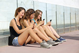 Group of teenager girls smiling happy texting on the smart phone