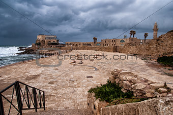 Ruins of harbor at Caesarea - ancient roman port in Israel
