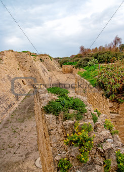 Ruins of the ancient Romanian harbor, Caesarea, Israel .
