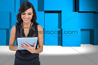 Composite image of smiling elegant brown haired model typing on tablet