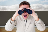 Composite image of positive businessman using binoculars