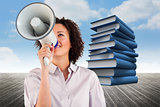 Composite image of businesswoman shouting through megaphone