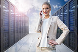 Composite image of cheerful elegant businesswoman on the phone