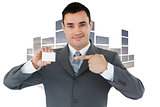 Composite image of businessman pointing at his businesscard