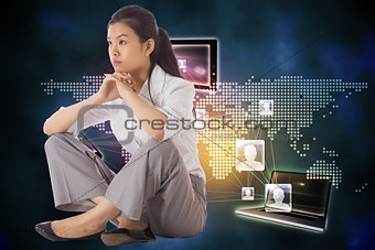 Composite image of thinking businesswoman sitting with hands together