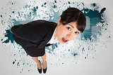 Composite image of surprised businesswoman bending
