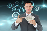 Composite image of businessman pointing at bank notes in his hand