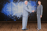 Composite image of businessman and woman shaking hands
