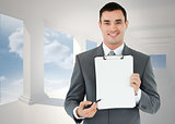 Composite image of businessman pointing with pen on clipboard