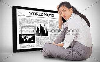 Composite image of depressed businesswoman sitting with hand on head