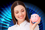 Composite image of confident businesswoman holding a piggybank