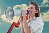 Composite image of beautiful businesswoman shouting through megaphone