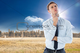 Composite image of thinking businessman with finger on chin
