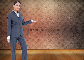 Composite image of standing businesswoman presenting