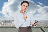 Composite image of elegant young businesswoman with clipboard