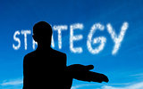 Composite image of strategy written in white in sky