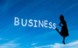 Composite image of business written in white in sky