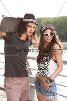 beautiful couple walking in city park