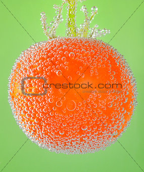 tomato immersed in mineral water