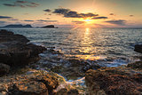 Sunrise over rocky coastline on Meditarranean Sea landscape in S