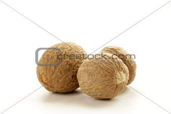 fragrant nutmeg spice on white background