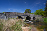 The ancient clapper bridge at Postbridges in Dartmoor National P