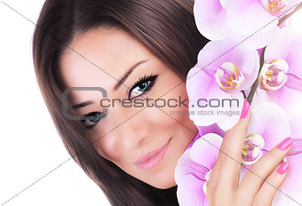 Beautiful female holding orchid flower