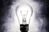 Electric light bulb with light textured background